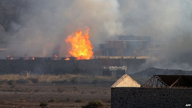 Flames and smoke at an arms depot in Yemen's second city, Aden, 28 March