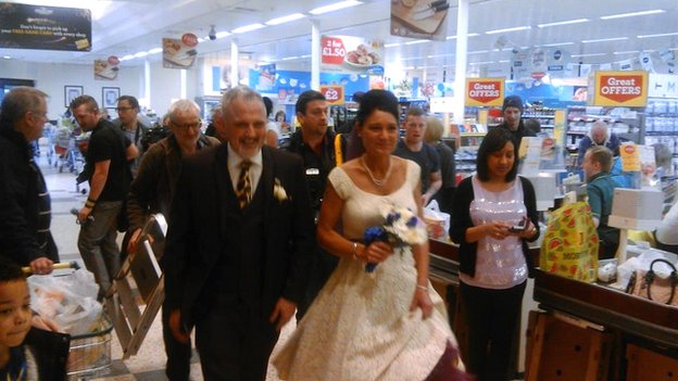 Rebecca Wooller and Blake Green exiting after getting married in Morrisons