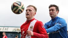 Linfield's Ross Clarke battles with Glenavon's Mark Patton at Mourneview Park
