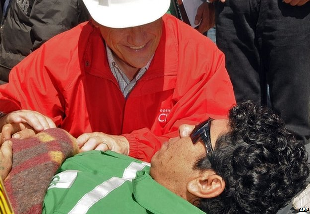 Victor Zamora as he is taken on a trolley to the field hospital after being brought to surface from the San Jose mine, near Copiapo, Chile, on October 13, 2010.