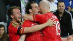 Gareth Bale (centre) celebrates