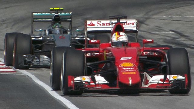 Vettel passes Rosberg & takes race lead