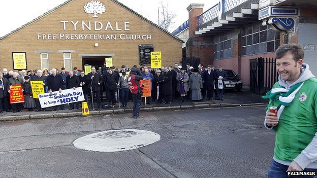 Dozens of protestors have gathered outside Tyndale Free Presbyterian Church near Windsor Park