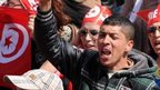 Close up of Tunisians in the capital, chanting as they take part in a protest against extreme violence