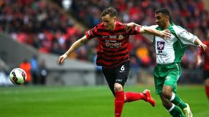Joe Clarke (L) of Wrexham looks to hold off Jason St Juste of North Ferriby during the The FA Carlsberg Trophy Final match between North Ferriby United and Wrexham at Wembley Stadium