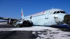 Day shot of damaged Air Canada Airbus 320 after it skidded off the runway after landing at Halifax International Airport