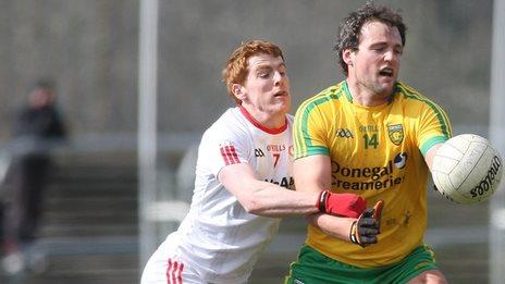 Michael Murphy battles with Peter Harte at Ballybofey