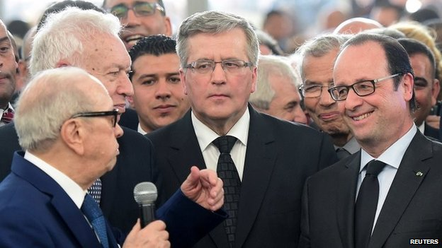 Spain's Foreign Minister Jose Manuel Garcia-Margallo (L), Poland's President Bronislaw Komorowski (C) and France's President Francois Hollande (R) listen to a speech by Tunisia's President Beji Caid Essebsi (front left) in Tunis, 29 March 2015