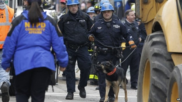 A search dog arrives at the site of a building collapse in the East Village neighborhood of New York, Friday, March 27, 2015