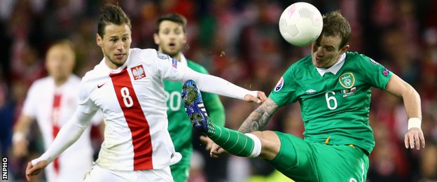 Poland's Grzegorz Krychowiak and the Republic of Ireland's Glenn Whelan