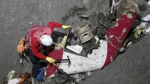 Workers at crash site, 29 March