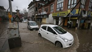 Vehicles move along flooded roads during rain in Srinagar, the summer capital of Indian Kashmir, 29 March 2015.