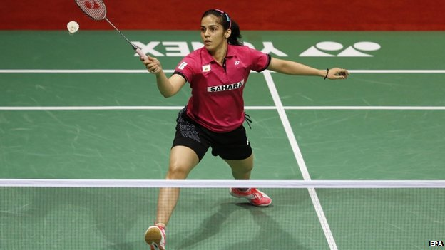 """India""""s Saina Nehwal returns a shot against Thailand""""s Ratchanok Intanon (unseen) in the Women""""s Single final match of Yonex India Open Superseries 2015 held in New Delhi, India on 29 March 2015."""