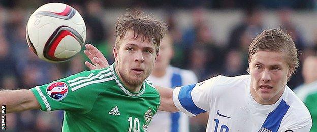Northern Ireland's Jamie Ward competes against Jere Uronen of Finland