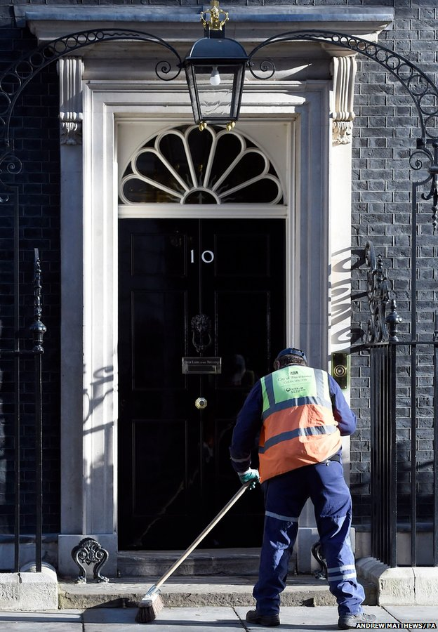A road sweeper makes his way past 10 Downing Street,
