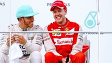 Sebastian Vettel (right) and Lewis Hamilton chat on the podium at the end of the Malaysian Grand Prix