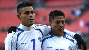 Darwin Ceren and Oscar Ceren walk off the field after losing to Argentina during an International Friendly