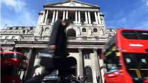 A pedestrian passes the Bank of England in London,