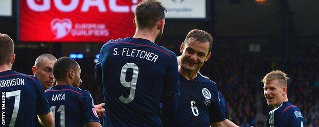 Steven Fletcher and Shaun Maloney celebrate against Gibraltar