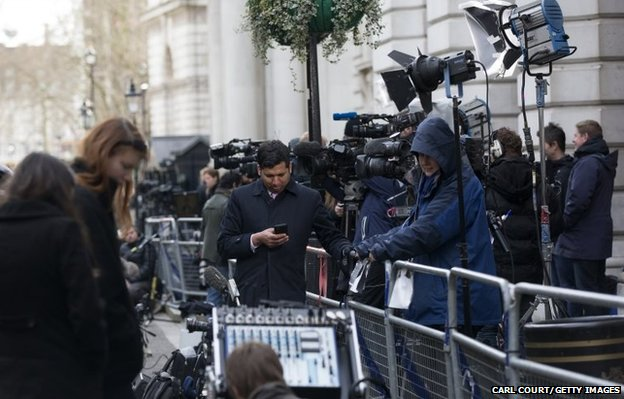 Members of the media gather in Downing Street