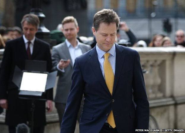 Deputy Prime Minister Nick Clegg walks to the Cabinet Office after speaking to reporters before going to Buckingham Palace