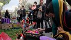 Iranians go shopping at a street market