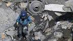 French rescue worker inspects debris near Seyne-les-Alpes