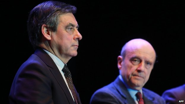 Former French prime ministers and UMP right-wing opposition party politicians Francois Fillon (L) and Alain Juppe (March 2015)