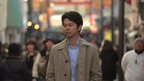 Japanese man in crowded street