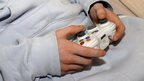 Boy playing on games console.