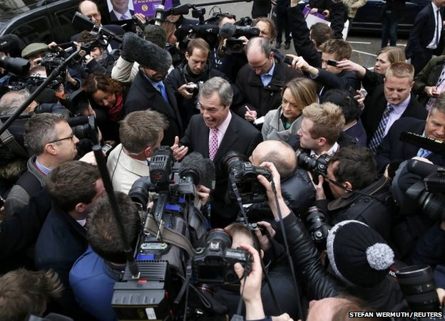 Nigel Farage surrounded by journalists