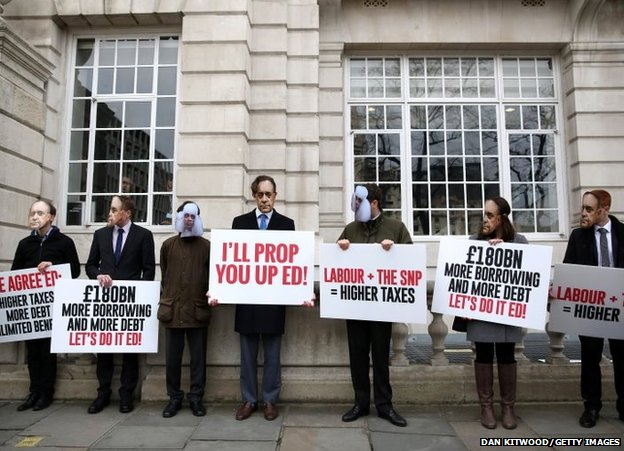 Demonstrators stand outside Bloomberg LP's European headquarters