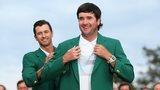 Bubba Watson is given his second green jacket by 2013 winner Adam Scott