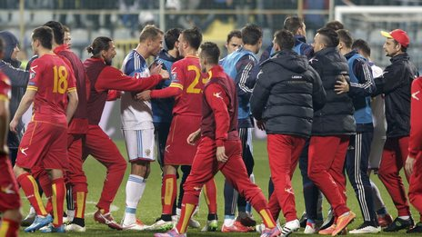 Russia and Montenegro players clash