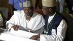 Independent National Electoral Commission chairman, Attahiru Jega, left, views election results in Abuja, Nigeria, 30 March 2015