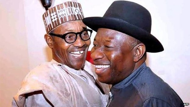 Nigerian President Goodluck Jonathan (R) and presidential candidate of the ruling People's Democratic Party (PDP) embraces leading opposition All Progressive Congress presidential candidate Mohammadu Buhari during a conference to promote non-violence attended by party leaders in Abuja, on 15 January 2015