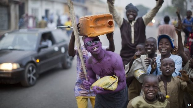 Supporters of opposition candidate Muhammadu Buhari celebrate an anticipated win for their candidate, in Kano, Nigeria Tuesday, 31 March 2015
