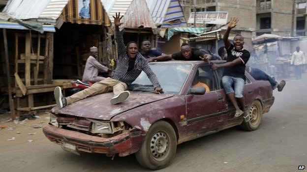 Nigerians celebrate the anticipated victory of presidential candidate Muhammadu Buhari in Kaduna, Nigeria Tuesday, 31 March 2015.