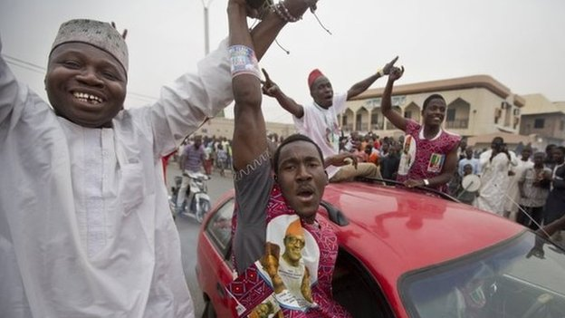 Supporters of opposition candidate Muhammadu Buhari celebrate an anticipated win for their candidate, in Kano, Nigeria on 31 March 2015.