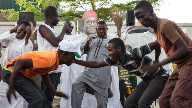 Nigerians in Kaduna dance in front of a picture of Muhammadu Buhari during the election voting days