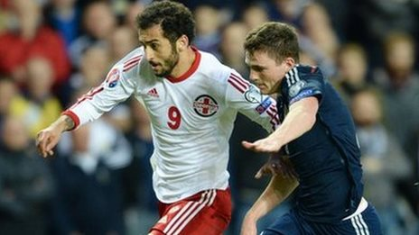 Scotland's Andrew Robertson (right) battles with Nikoloz Gelashvill