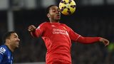 Raheem Sterling controls the ball against Everton's Aaron Lennon
