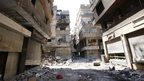 File photo: A general view of a street in the Yarmuk refugee camp in the Syrian capital Damascus, 12 September 2013
