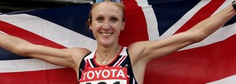 Paula Radcliffe celebrates winning marathon gold at the 2005 World Championships