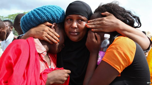 Some of the Garissa University students who were rescued, comfort each other at the Garissa military camp on 3 April 2015