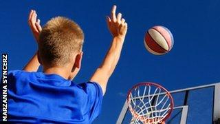 children shooting a hoop