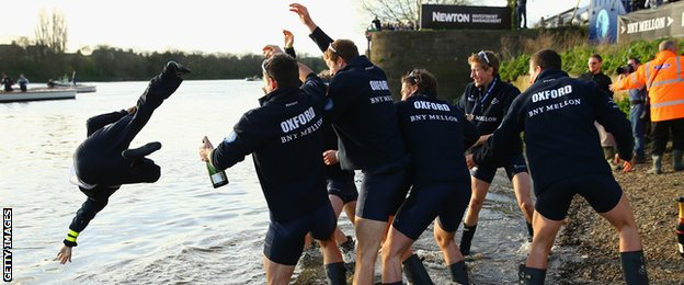 Oxford throw their cox in the water