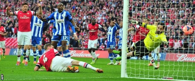 Per Mertesacker scores an 82nd-minute equaliser for Arsenal against Wigan