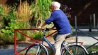 An old man cycling