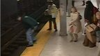 Moment Charles Collins jumps from subway platform in Philadelphia to rescue man on tracks (not in view)